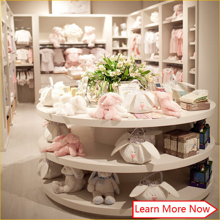 Customized high quality baby kids clothes store interior design pemasok